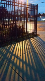10 16 2014 shadowy sidewalk fence at CASHS (2)
