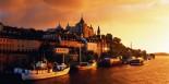 Sweden, Stockholm, Sodermalm, Lake Malaren, boats and town hall,sunset